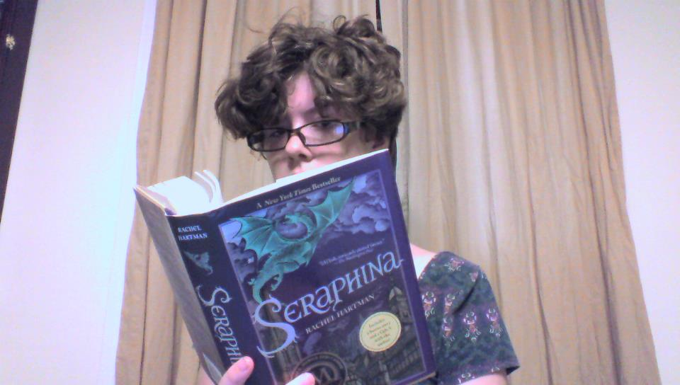 pic of me reading Seraphina